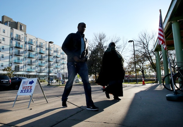Voters head to the Brian Coyle Center in Minneapolis to cast their vote Tuesday, Nov. 7, 2017. A Republican proposal at the Legislature would prevent