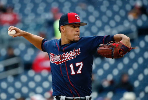 Minnesota Twins starting pitcher Jose Berrios throws during the third inning of a spring exhibition baseball game against the Washington Nationals at