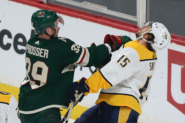 Minnesota Wild's Nate Prosser (39) shoves Nashville Predators' Craig Smith (15) in the first period of an NHL hockey game Saturday, March 24, 2018, in