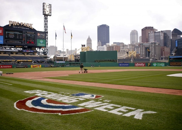 A ground crew worker prepares the infield at PNC Park before the Pirates' home opener baseball game against the Minnesota Twins, Monday, April 2, 2018