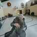 Allan Law, 73, who has helped the needy for more than 50 years, hugged a former student at the Little Earth gym.
