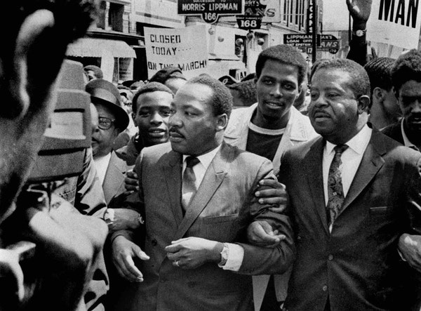 On March 28, 1968, the Rev. Martin Luther King Jr. and the Rev. Ralph Abernathy, right, led a march on behalf of striking sanitation workers in Memphi