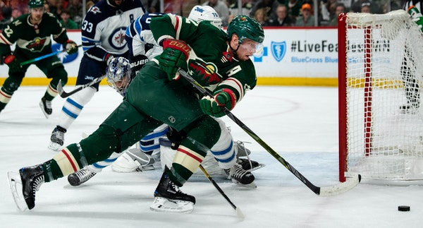 The Wild's Eric Staal chased the puck in the first period against the Jets during Game 4
