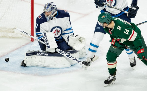 Matt Dumba (not in frame) got the puck past Connor Hellebuyck (37) for a goal in the second period on Sunday.