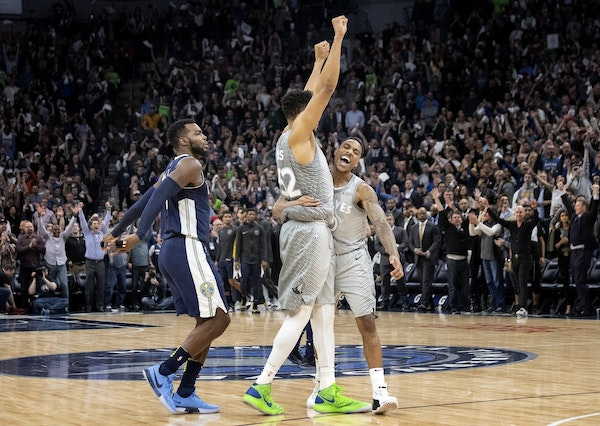 Minnesota Timberwolves Karl-Anthony Towns and Jeff Teague celebrated at the end of Wednesday night's game that clinched a spot in the NBA playoffs.