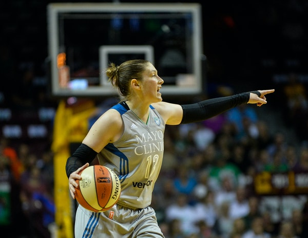 Minnesota Lynx guard Lindsay Whalen (13) directed teammates during the second quarter Tuesday as she moved the ball down the court. It was Whalen's fi