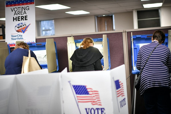 Voters cast early ballots at a voting center in Minneapolis on Sept. 23, 2016. The DFL is hoping to energize young voters.