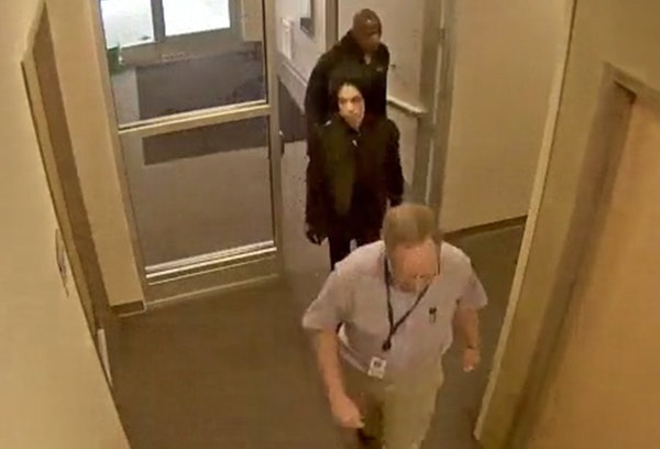 Prince, center, entered the clinic of Dr. Michael T. Schulenberg's clinic on April 20, 2016. Kirk Johnson is behind Prince.
