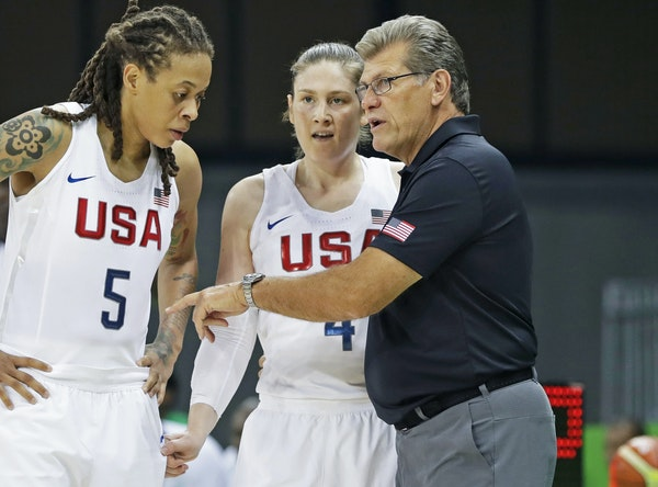 Lindsay Whalen and teammate (on both Team USA and the Lynx) Seimone Augustus, left, listened to U.S. head coach Geno Auriemma during a game in the 201