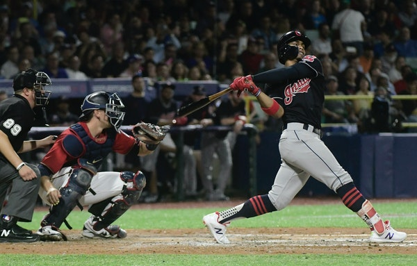 Cleveland's Francisco Lindor hits a home run against the Minnesota Twins during the fifth inning at Hiram Bithorn Stadium in San Juan