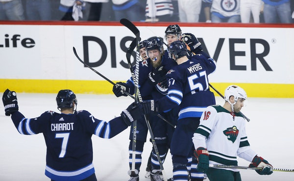 The Jets celebrated a goal by Patrick Laine (29) in front of a dejected Wild winger Jason Zucker on Friday.