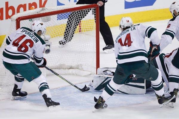 Minnesota Wild's Jared Spurgeon saved a Jets shot that got past goaltender Devan Dubnyk on Wednesday in the opener of their NHL playoff series in Winn