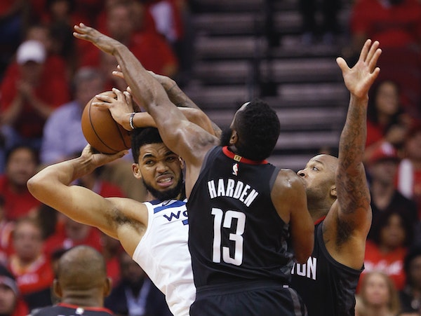 Minnesota Timberwolves center Karl-Anthony Towns is cornered by Rockets guard James Harden and forward PJ Tucker during the first half of Game 5
