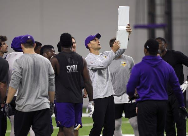 Vikings quarterback Kirk Cousins got a head-start on the new game plan.
