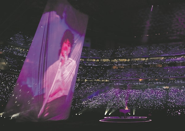 """Accompanied by a huge projection of Prince singing, Justin Timberlake played the piano and duetted on """"I Would Die 4 U"""" during halftime at the Sup"""