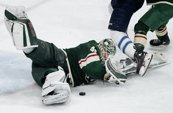Wild goaltender Devan Dubnyk came out of his crease as he challenged a shot attempt in the third period of Game 4 against the Jets.