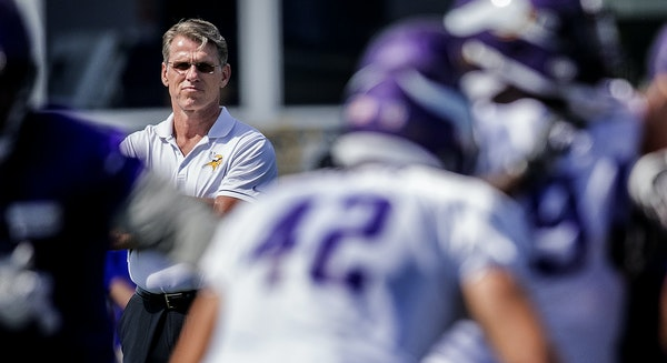 Minnesota Vikings general manager Rick Spielman. watches the results of his draft-dealing at training camp in July 2017.