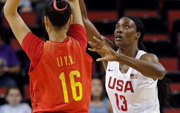 Sylvia Fowles (13) defends against China's Yueru Li during the first half of an exhibition basketball game Thursday, April 26, 2018, in Seattle. The U