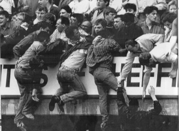 Some Liverpool fans were pulled to safety during a crowd crush at Hillsborough Stadium 29 years ago, but 96 died.