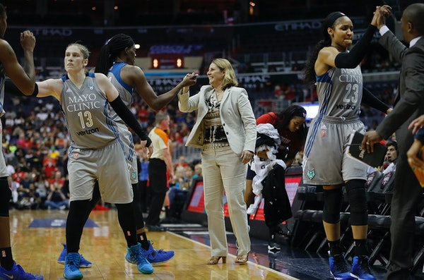Lynx head coach Cheryl Reeve greets Sylvia Fowles as other members of the team celebrate during a game last postseason.