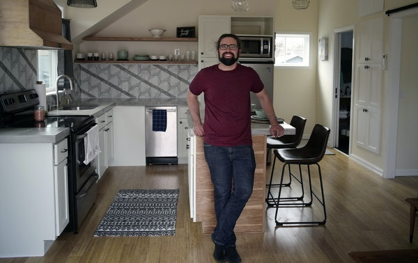 """Eric Larsen is one of the homeowners near the Green Line who has added an """"accessory dwelling unit"""" to his property above a garage in St. Paul."""
