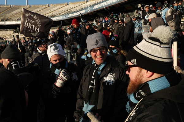 Minnesota United fans stood bundled up in the stands prior to the start of the first half.