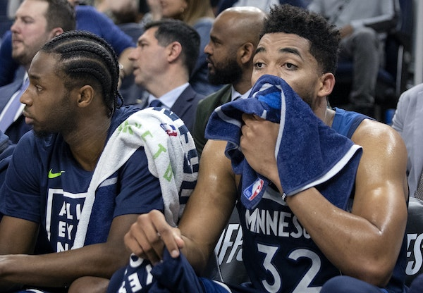 Andrew Wiggins and Karl-Anthony Towns watched the final minutes of Monday's loss.