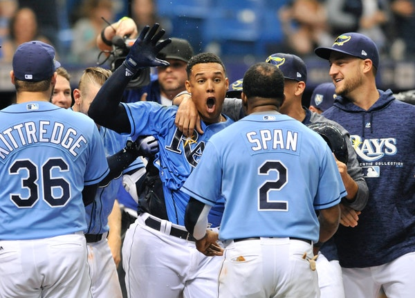 The Rays' Carlos Gomez, center, celebrated with teammates after hitting a two-run walkoff homer off Twins reliever Addison Reed in the ninth inning Su