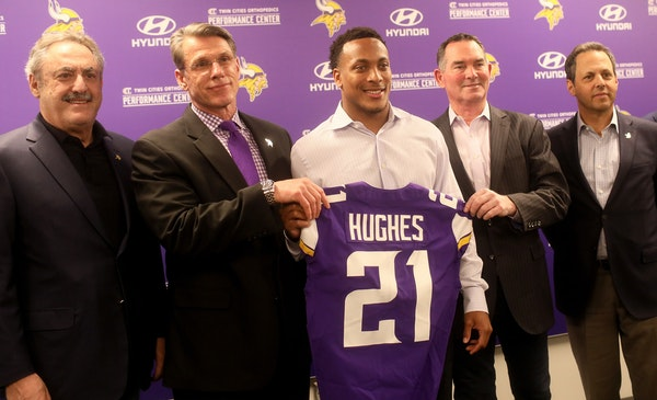 Minnesota Vikings first round pick cornerback Mike Hughes from the University of Central Florida, surrounded by Zygi Wilf, Vikings owner, left to righ