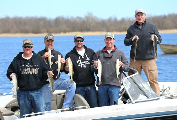 Reaching their limits: Twin Cities anglers on Upper Red Lake during Saturday's opener found plenty of fish biting. From left, Pete Mogren, John Hero