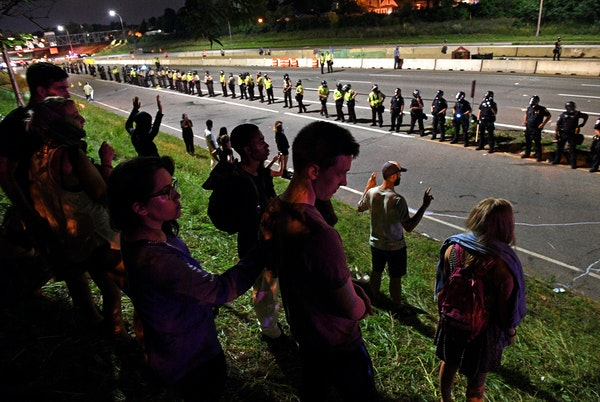 Protestors stood facing Interstate 94 after police forced them off the freeway near Dale St. in St. Paul on July 11, 2016. The protest was in response