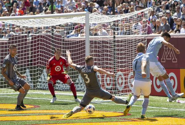 Loons defender Jerome Thiesson (3) defended against Sporting KC's Johnny Russell during Sunday's game at TCF Bank Stadium.