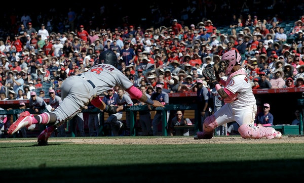 The Twins' Ehire Adrianza was tagged out by Angels catcher Martin Maldonado trying to score on a double by Robbie Grossman in the ninth inning Sunday.