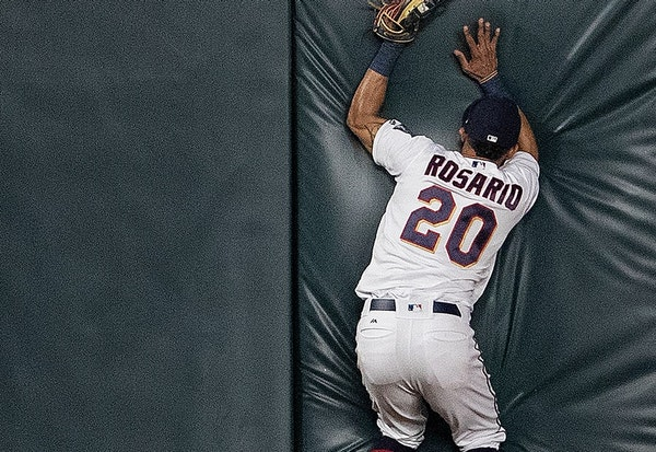 Twins left fielder Eddie Rosario (20) caught a ball at the fence hit by John Hicks to end the game.