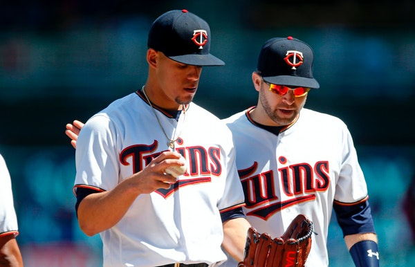 Twins starter Jose Berrios, left, got a pep talk from second baseman Brian Dozier in the third inning of Cincinnati's 8-2 victory at Target Field on S