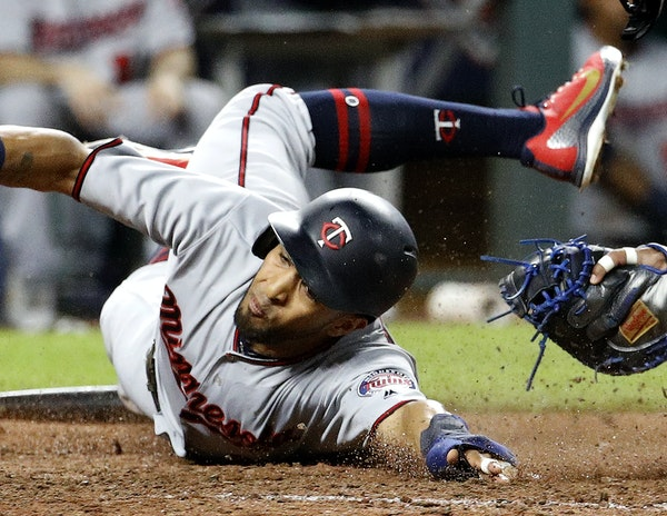 Eddie Rosario beat the tag by Royals catcher Salvador Perez to score on a two-run double by Miguel Sano in the sixth inning.
