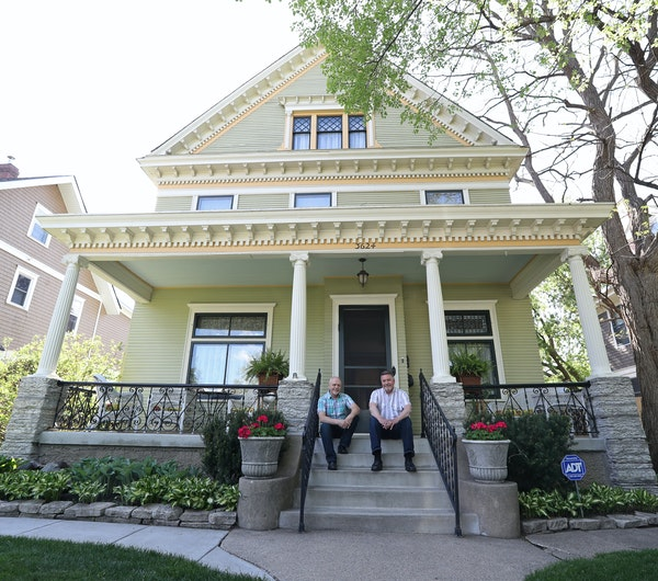 Gary Anderson, left, and Tom Waade on the front steps of their 120-year-old home on historic Park Avenue S. in Minneapolis.
