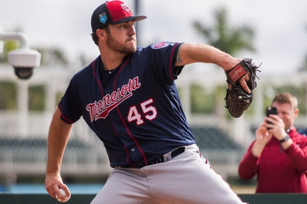 Twins to carry 12 pitchers, for now, with LaMarre's return