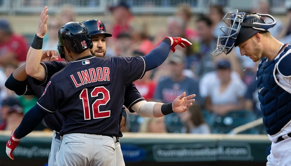 Francisco Lindor is congratulated by Jason Kipnis after hitting a three-run home run in the fourth inning against the Twins on Thursday
