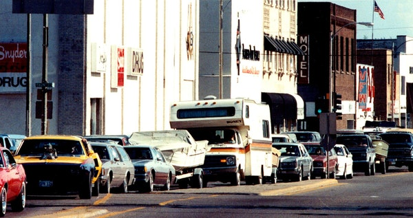 In this 1989 file photo, cars filled with weekend travelers line up on 6th Street in Brainerd.