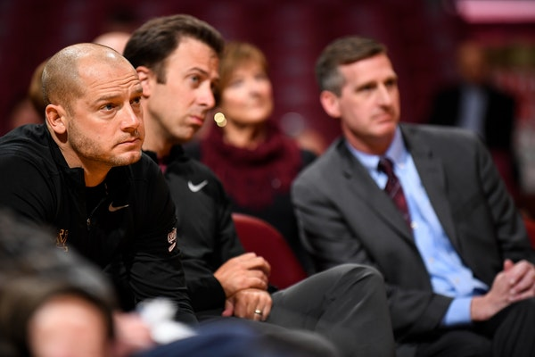 From left, Gophers football head coach PJ Fleck, basketball head coach Richard Pitino and athletic director Mark Coyle watched Lindsay Whalen's introd