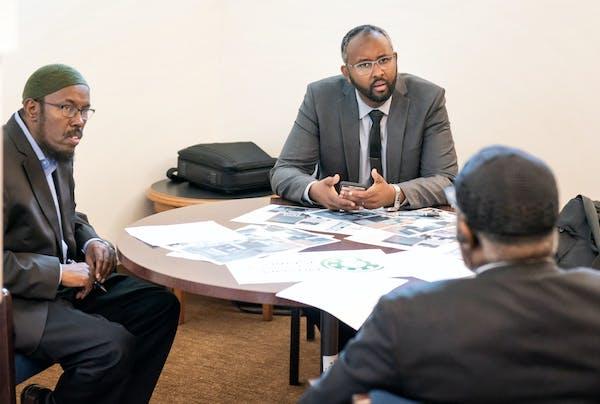 Abdulaziz Sugule of the Somali American Money Services Association, Jaylani Hussein of CAIR-Minnesota and Imam Hassan Mohamud of the Islamic Dawah Cen
