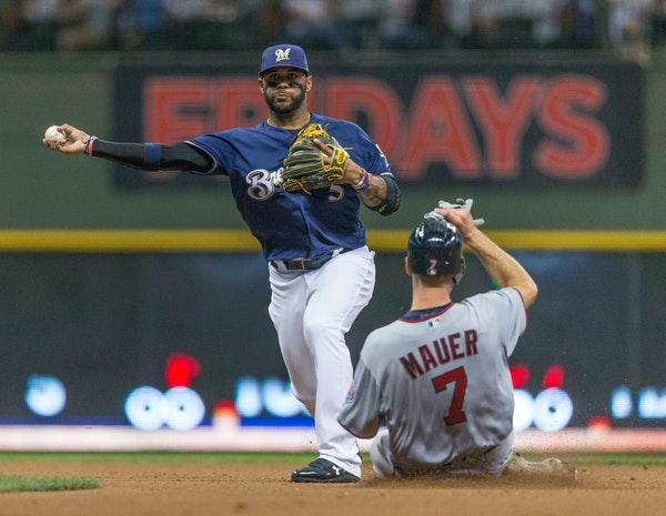 Milwaukee Brewers' Jonathan Villar turns the double play after getting Minnesota Twins' Joe Mauer at second base during a Border Battle game in 2017.