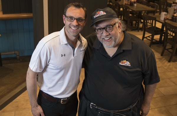 Famous Dave's new CEO Jeff Crivello, left, and founder Dave Anderson have put their heads together to reimagine the once-thriving restaurant concept