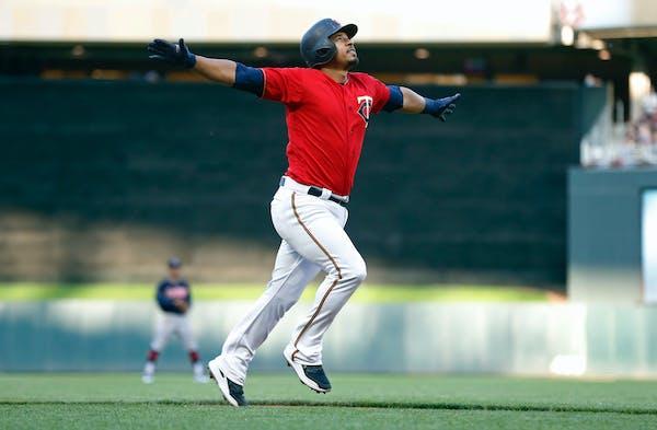 Eduardo Escobar celebrates his three-run home run off Indians pitcher Carlos Carrasco in the first inning Friday night.