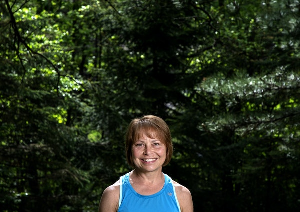 Sue Olsen, before a run Tuesday. Olsen is closing in on 3,000 miles total in her years of running FANS.