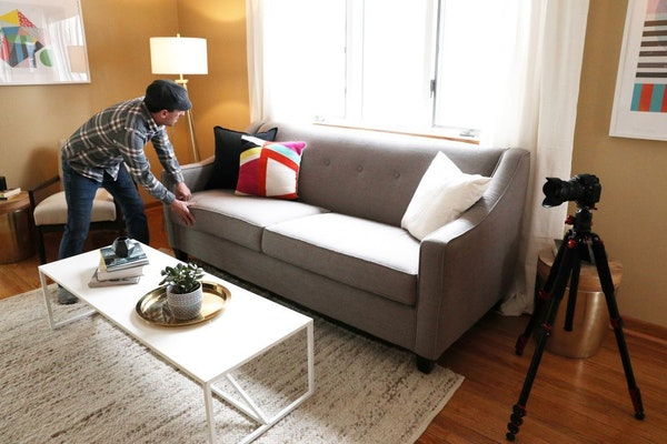 Jason Boyd prepared to photograph a Minneapolis home for listing by Becky Quinby.