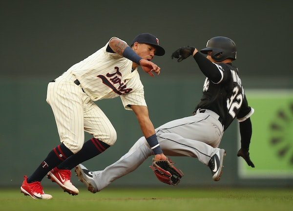 The Chicago White Sox's Trayce Thompson successfully steals second base in the third inning when the throw from catcher Mitch Garver to Twins shortsto
