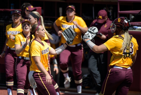 Pitcher Amber Fiser, left, and catcher Kendyl Lindaman are two team leaders for the Gophers.