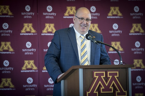Bob Motzko, the new Gophers hockey coach hired away from St. Cloud, did not appear with other U of M coaches at a stop in the Granite City on Wednesda